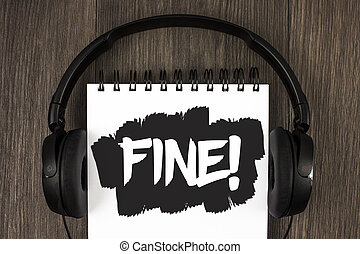 Word writing text Fine Motivational Call. Business concept for No hidden charges from large moving companies written on Notepad on the wooden background Headphone next to it.