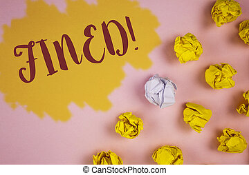 Word writing text Fined Motivational Call. Business concept for No penalty charge for late credit card bill payment written on Painted background Crumpled Paper Balls next to it.