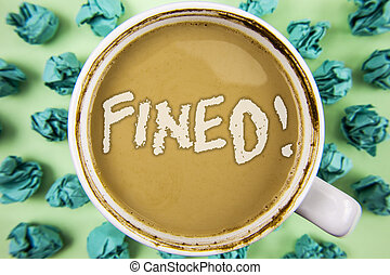 Word writing text Fined Motivational Call. Business concept for No penalty charge for late credit card bill payment written on Tea in White Cup within Crumpled Paper Balls on plain background.