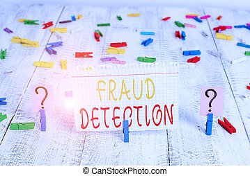 Word writing text Fraud Detection. Business concept for identification of actual or expected fraud to take place Scribbled and crumbling sheet with paper clips placed on the wooden table.
