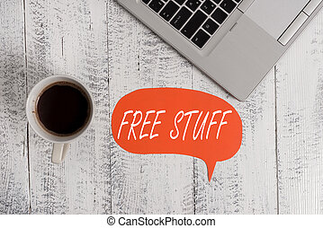 Word writing text Free Stuff. Business photo showcasing Any thing that you can have in a store that is not being paid Trendy metallic open laptop speech bubble vintage wooden table coffee cup