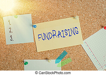 Word writing text Fundraising. Business concept for seeking to generate financial support for charity or cause Corkboard color size paper pin thumbtack tack sheet billboard notice board.
