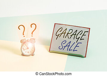 Word writing text Garage Sale. Business concept for sale of miscellaneous household goods often held in the garage Mini size alarm clock beside a Paper sheet placed tilted on pastel backdrop.