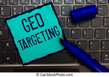 Word writing text Geo Targeting. Business concept for Digital Ads Views IP Address Adwords Campaigns Location Turquoise paper keyboard Inspiration communicate idea messages blue markers.
