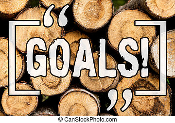 Word writing text Goals. Business concept for Desired Achievements Targets What you want to accomplish in the future Wooden background vintage wood wild message ideas intentions thoughts.