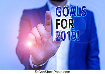 Word writing text Goals For 2019. Business concept for object of demonstratings ambition or effort aim or desired result Businessman in blue suite and white shirt pointing with finger in empty space.