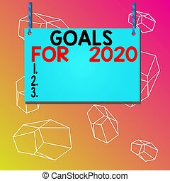 Word writing text Goals For 2020. Business concept for The following things you want to have and achieve in 2020 Wooden board wood rectangle shape empty frame fixed colorful striped string.