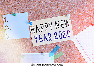 Word writing text Happy New Year 2020. Business concept for celebration of the beginning of the calendar year 2020 Corkboard color size paper pin thumbtack tack sheet billboard notice board.
