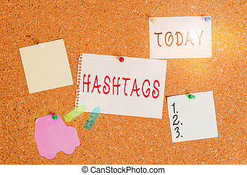 Word writing text Hashtags. Business concept for a word or phrase preceded by a hash sign Type of metadata tag Corkboard color size paper pin thumbtack tack sheet billboard notice board.