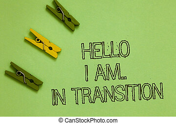 Word writing text Hello I Am.. In Transition. Business concept for Changing process Progressing planning new things Outline words green middle yellow paper clip on olive color ground.