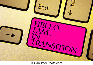 Word writing text Hello I Am.. In Transition. Business concept for Changing process Progressing planning new things Bright golden computer keyboard with pink button black color written texts.