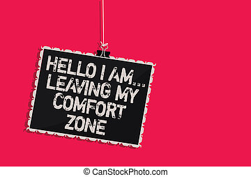Word writing text Hello I Am... Leaving My Comfort Zone. Business concept for Making big changes Evolution Growth Hanging blackboard message communication information sign pink background.