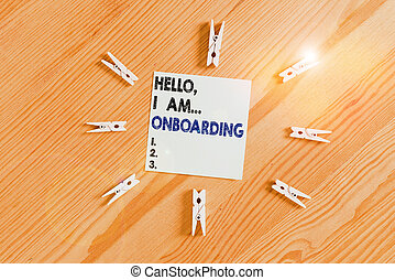 Word writing text Hello I Am Onboarding. Business concept for telling demonstrating that you are on ship or plane Colored clothespin papers empty reminder wooden floor background office.