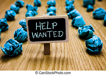 Word writing text Help Wanted. Business concept for advertisement placed in newspaper by employers seek employees Blackboard crumpled papers several tries mistake not satisfied wooden floor.