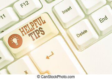 Word writing text Helpful Tips. Business concept for secret information or advice given to be helpful knowledge White pc keyboard with empty note paper above white background key copy space.