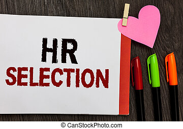 Word writing text Hr Selection. Business concept for Process and approached by human resources when hiring employees Open notebook page markers clothespin holding paper heart wooden background.