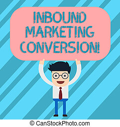 Word writing text Inbound Marketing Conversion. Business concept for process of attracting the attention of prospect Man Standing Holding Above his Head Blank Rectangular Colored Board.