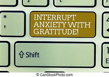 Word writing text Interrupt Anxiety With Gratitude. Business concept for Be thankful and less stressed out Keyboard key Intention to create computer message, pressing keypad idea.