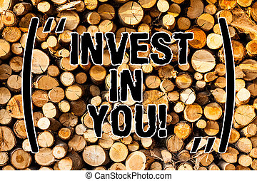 Word writing text Invest In You. Business concept for Take care of yourself buy things for you Motivation Inspire Wooden background vintage wood wild message ideas intentions thoughts.