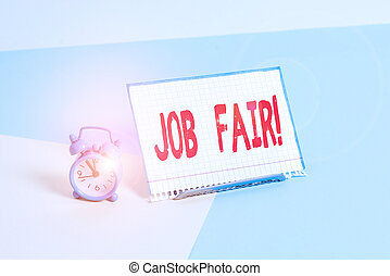 Word writing text Job Fair. Business concept for event in which employers recruiters give information to employees Mini size alarm clock beside a Paper sheet placed tilted on pastel backdrop.