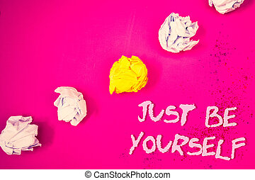 Word writing text Just Be Yourself. Business concept for Self Attitude Confidence True Confident Honesty Motivation Words pink background crumbled paper notes yellow white diagonal stress.