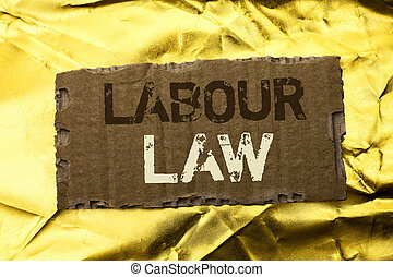 Word writing text Labour Law. Business concept for Employment Rules Worker Rights Obligations Legislation Union written on tear Cardboard Piece on the Golden textured background.
