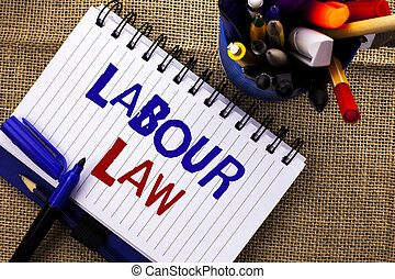 Word writing text Labour Law. Business concept for Employment Rules Worker Rights Obligations Legislation Union written on Notebook Book on the jute background Pencils next to it.
