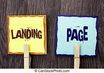Word writing text Landing Page. Business concept for Website accessed by clicking a link on another web page written on Sticky Note Papers Holding with Wooden Clip on the wooden background.