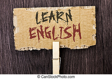 Word writing text Learn English. Business concept for Study another Language Learn Something Foreign Communication written on Cardboard Piece Holding With Clip on the wooden background.