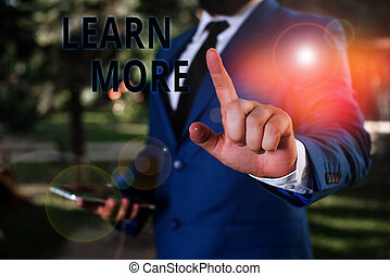 Word writing text Learn More. Business concept for knowledge or skill acquired by instruction Considerable learning Businessman with pointing finger in front of him.