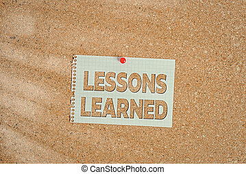 Word writing text Lessons Learned. Business concept for the knowledge or understanding gained by experience Corkboard color size paper pin thumbtack tack sheet billboard notice board.
