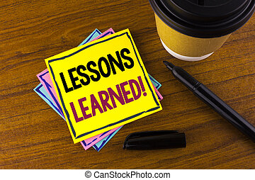 Word writing text Lessons Learned Motivational Call. Business concept for Academic student development optimization written on Sticky Note Paper on wooden background Marker Cup next to it.