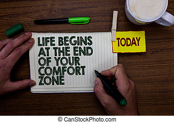 Word writing text Life Begins At The End Of Your Comfort Zone. Business concept for Make changes evolve grow Man holding marker notebook clothespin reminder wooden table cup coffee.