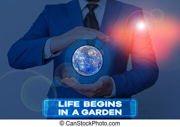 Word writing text Life Begins In A Garden. Business concept for Agriculture Plants growing loving for gardening Elements of this image furnished by NASA.