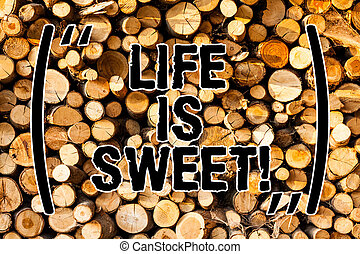 Word writing text Life Is Sweet. Business concept for Happiness seeing the good side of events Motivation Inspire Wooden background vintage wood wild message ideas intentions thoughts.