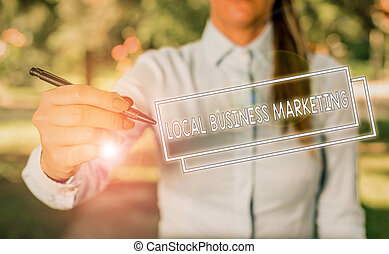 Word writing text Local Business Marketing. Business photo showcasing Localized specification on Store characteristic Woman in a blue business shirts pointing with her finger into empty space
