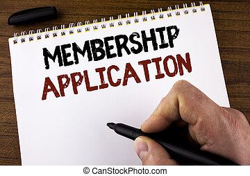 Word writing text Membership Application. Business concept for Registration to Join a team group or organization written by Man on Notepad holding Marker on the Wooden background.