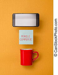 Word writing text Mobile Commerce. Business concept for Using mobile phone to conduct commercial transactions online Coffee cup colored sticky note electronic device yolk color background.