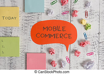 Word writing text Mobile Commerce. Business concept for Using mobile phone to conduct commercial transactions online Blank speech bubble paper balls clips sticky notes old wooden background.