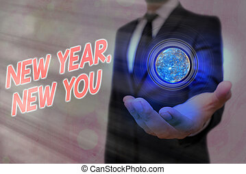 Word writing text New Year, New You. Business concept for coming January Changing an individualality for a better an individual Elements of this image furnished by NASA.