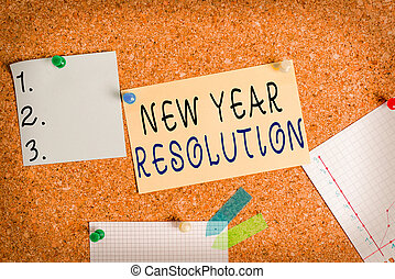 Word writing text New Year Resolution. Business concept for listing of goals and change with determination Corkboard color size paper pin thumbtack tack sheet billboard notice board.