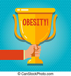 Word writing text Obesity. Business concept for Medical condition Excess of body fat accumulated Health problem Hand Holding Blank Golden Championship Winners Cup Trophy with Reflection.