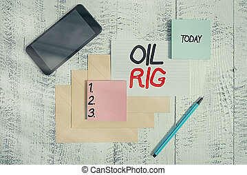 Word writing text Oil Rig. Business concept for large structure with equipment to remove oil from under the seabed Envelopes marker ruled paper smartphone sheet note pads wooden background.