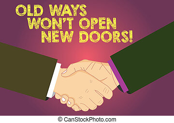 Word writing text Old Ways Won T Open New Doors. Business concept for Change way you do things to accomplish goals Hu analysis Shaking Hands on Agreement Greeting Gesture Sign of Respect photo.