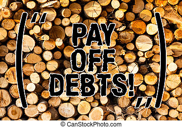Word writing text Pay Off Debts. Business concept for Payment for thing you have in debt Mortgages Investments Wooden background vintage wood wild message ideas intentions thoughts.