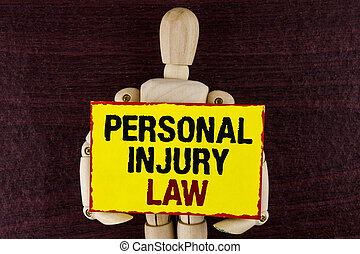 Word writing text Personal Injury Law. Business concept for guarantee your rights in case of hazards or risks written on Sticky note paper holding by Wooden Robot Toy on wooden background.