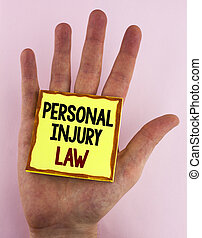 Word writing text Personal Injury Law. Business concept for guarantee your rights in case of hazards or risks written on Sticky Note Paper placed on the Hand on the plain background.