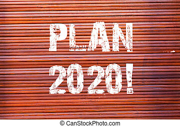 Word writing text Plan 2020. Business concept for detailed proposal doing achieving something next year Brick Wall art like Graffiti motivational call written on the wall.