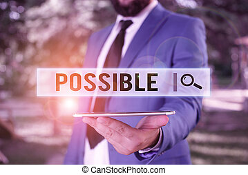 Word writing text Possible. Business concept for something that can happen May exist but that is not certain Businessman in blue suite stands with mobile phone in hands.