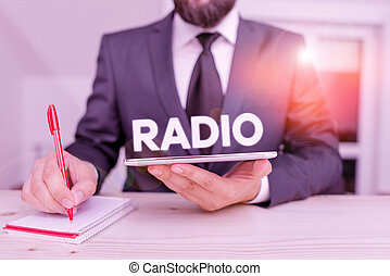 Word writing text Radio. Business concept for activity or industry of broadcasting sound programmes to the public Male human wear formal clothes present presentation use hi tech smartphone.